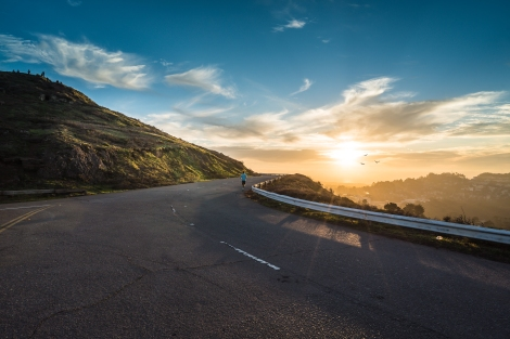 sunset_road_mountain_person_running_unsplash