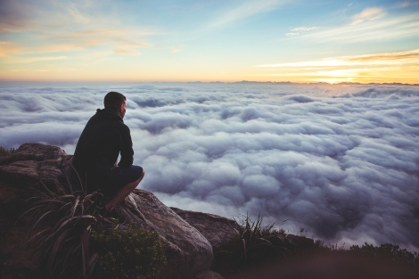 thinking_man_mountain_sky_clouds_unsplash